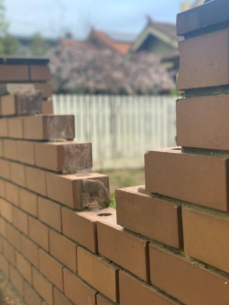 Image shows a brick fence needing brick repairs in Ballarat