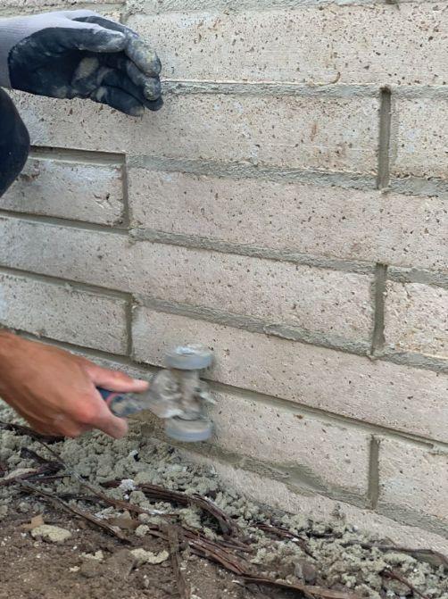 Retaining wall being built by bricklayer ballarat